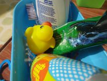 Yellow duck among toiletries. Yellow duck toy among toiletries shooted at the daylight royalty free stock image