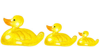 Yellow ducklings toys each other swimming Stock Images