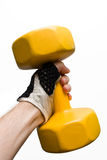 Yellow dumbbell in a male hand isolated royalty free stock photography