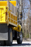 Yellow Dump Truck Detail. (Rear View royalty free stock image