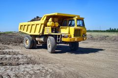 Yellow dump truck. Dump truck on the construction site royalty free stock photography