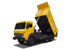 Yellow dump truck. With shadow isolated on white background Stock Images