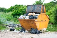 Yellow dumpster Royalty Free Stock Photo
