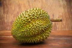 Yellow durian on wood table, Fresh fruit from orchard, King of fruit from Thailand, Many people like this fruit Stock Images