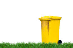 Yellow dustbin on green lawn Royalty Free Stock Images
