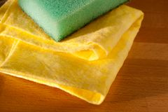 Yellow dusters and bath sponge Stock Photography