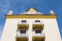 Yellow dwelling house with tower and balcony Royalty Free Stock Photography