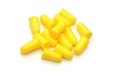 Yellow earplugs Stock Images