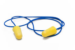 Yellow earplugs with blue band. On white background Royalty Free Stock Photography
