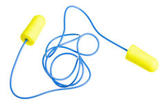 Yellow earplugs with blue band Royalty Free Stock Images