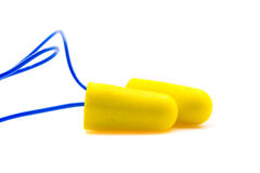 Yellow earplugs with blue band. Royalty Free Stock Image