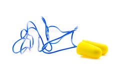 Yellow earplugs with blue band. Royalty Free Stock Photography