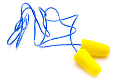 Yellow earplugs with blue band. Stock Images