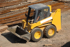 Yellow earth mover Stock Images