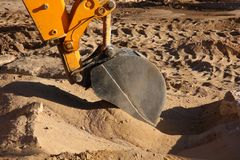A yellow earth mover in action. royalty free stock photos