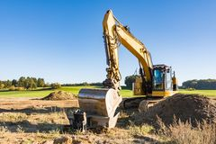 Yellow earth mover at a construction site Stock Image