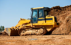 Yellow Earth Mover by Pile of Dirt Stock Photos