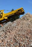 Earth moving machine in action stock image