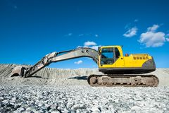 Excavator. A yellow earthmover parked on the building site Stock Photo