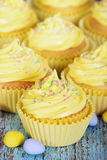 Yellow Easter cupcakes Stock Photos