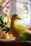 Yellow Easter duck. In the interior stock photo
