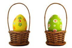 Yellow Easter egg into a basket. Yellow and green Easter egg into a basket on white background Royalty Free Stock Photo