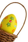 Yellow Easter egg into a basket Royalty Free Stock Photography