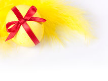 Yellow Easter egg with feather Stock Photos