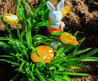 Yellow Easter egg in a garden Stock Photo