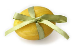 Yellow Easter Egg tied with a ribbon Stock Photo