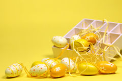 Yellow Easter eggs with a box Royalty Free Stock Photo