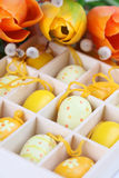 Yellow Easter eggs and tulips Royalty Free Stock Photo