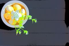 Yellow Easter eggs and white flowers with dark wooden background royalty free illustration