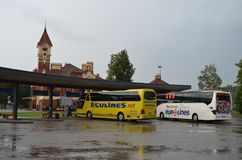 Yellow Ecolines buses and white Eurolines at a station in Mariampol, Latvia stock images
