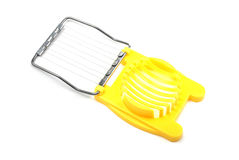 Yellow egg cutter. Royalty Free Stock Photo