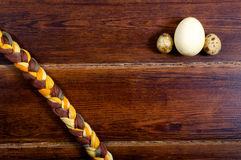 Yellow egg and quail eggs with moulinet braid Stock Image