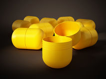 Yellow egg surprise capsules. 3D illustration Stock Image