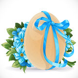 Yellow egg tied with a blue ribbon with a bouquet forget-me-not Royalty Free Stock Photo