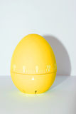 Yellow egg timer in front of white background Royalty Free Stock Photos