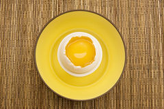Yellow Egg Yolk in a Cracked Eggshell Stock Photography