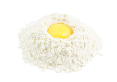 Yellow egg yolk in the flour isolated Stock Photo