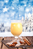 Yellow eggnog in winter landscape Stock Image