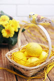 Yellow eggs in basket Stock Photo