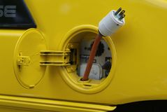 Yellow Electric Car Gas Tank Plug  Royalty Free Stock Image