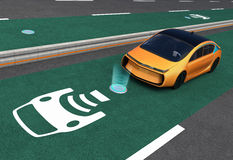 Yellow Electric Car On EV Wireless Charging Lane Royalty Free Stock Photography