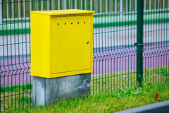 Yellow electric control box outdoor. Urban power and energy. Royalty Free Stock Photo