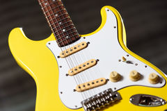 Yellow electric guitar stock photo