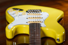Yellow electric guitar with strings stock photo