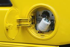 Yellow electric plug Stock Photo