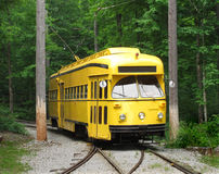 Yellow Electric Streetcar On Tracks Royalty Free Stock Images